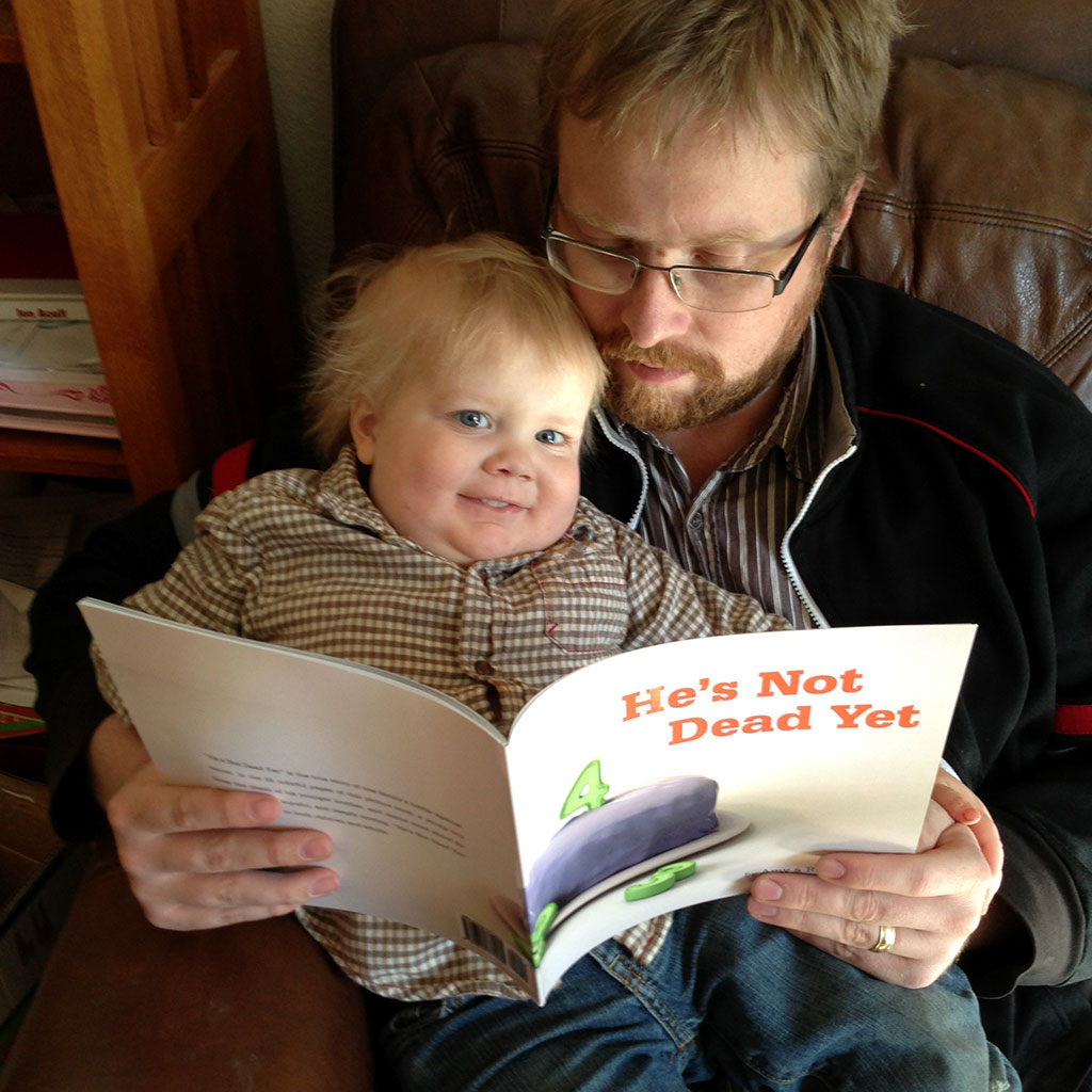 Joel and Daddy proof reading the paperback.